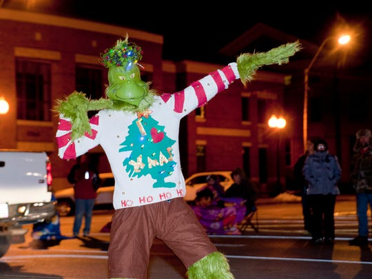 The Grinch strikes a pose during the Santa Parade Friday evening in downtown Bucyrus.
