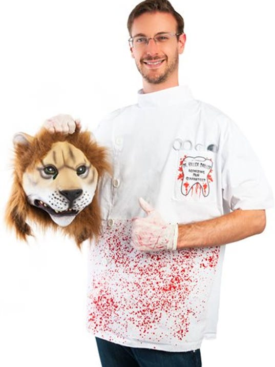 This image released by Costumeish shows a man holding a fake lion head while dressed as a dentist, a costume referring to the Minnesota dentist who who killed Cecil the lion.