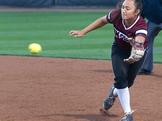 New Mexico State's Brennalyn Nakamura chases down this line drive for the final out in the top of the seventh inning as the Aggies lost to the Missouri Tigers Saturday evening at the NMSU Softball Complex.