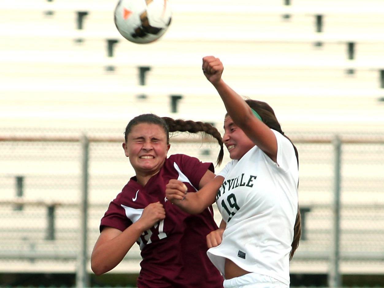 Morristown's Holly Burns, l, and Montville freshman Gianna Coppola vie for a header during their girls soccer matchup in early September. Montville, NJ.