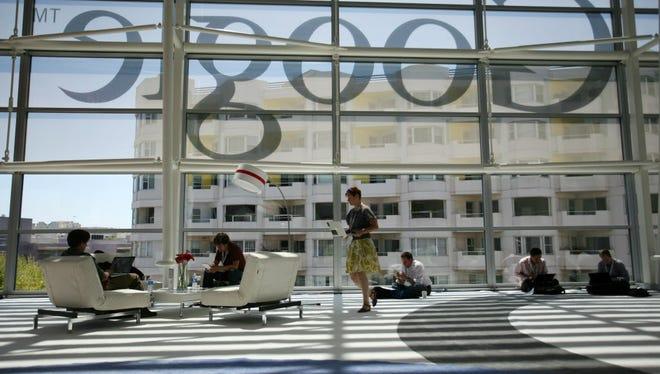 This June 28, 2012 file photo shows a Google logo seen through windows of Moscone Center in San Francisco, California.
