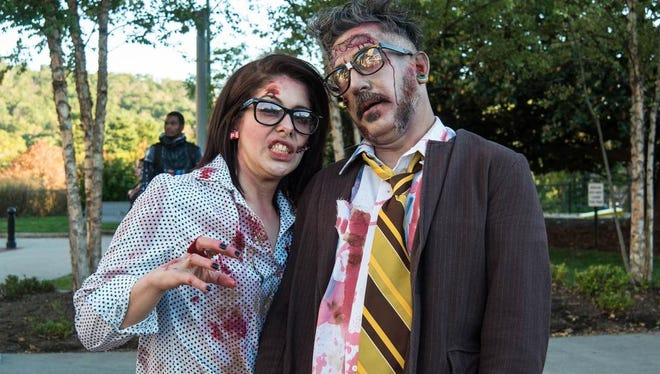 Zombies of all ages and walks of life took part in the fun at the 2015 Asheville Zombie Walk at Pack Square.
