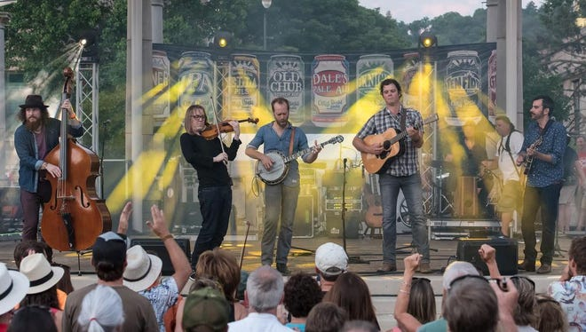 On the Scene with Steep Canyon Rangers for a free show at Pack Square Park. Opening band was Asheville's own Devils in Dust.