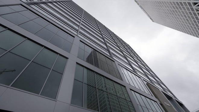 The Johnson Controls International automotive business, to be spun off from the Irish company on Oct. 31, will be run from the 833 East building in downtown Milwaukee.