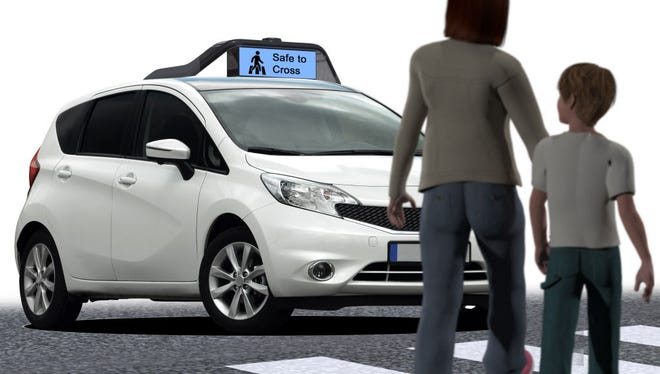 Illustration of a self-driving car tech kit, which could communicate its intentions visually to pedestrians.