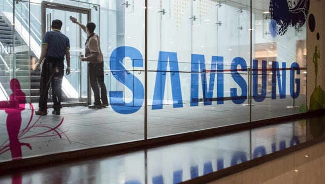 A Samsung logo is displayed in a mall beneath the company's headquarters in the Gangnam district of Seoul on October 12, 2016.