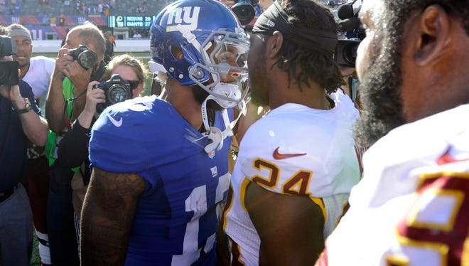 Giants wide receiver Odell Beckham (13) and Washington Redskins cornerback Josh Norman talk after the teams played in September.