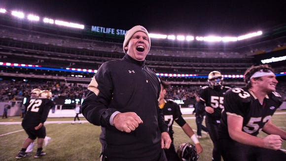River Dell head football coach DJ Nimphius celebrates after the Hawks sectional title in 2016. Nimphius will be a featured speaker at the Northeast Football Coaches Clinic.