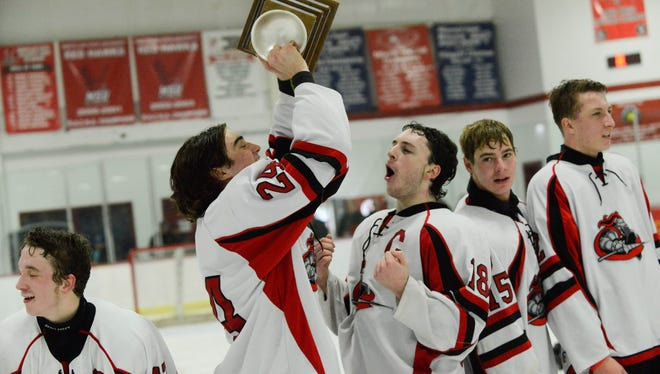 Lakeland's Ryan Gorman hoists the Passaic County Tournament championship trophy after the Lancers defeated Clifton on Monday night for the program's fourth county title in the last six years.