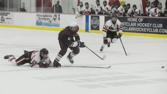 Clifton hockey player Nick Petriella (center).