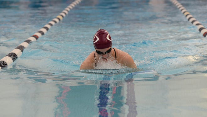 Ridgewood's Ashleigh Afromsky was part of two winning relays, the 200 medley and the 400 freestyle, Wednesday at the Big North Freedom league championships to help lead the Maroons to team title. The Ridgewood boys also won their meet.