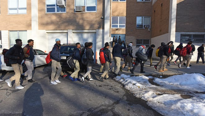 Kennedy High School basketball team arrives at Eastside High School in Paterson. The game was closed to the general public, a decision reached as investigators examine allegations that six Eastside players may have been living in their coach's condo.