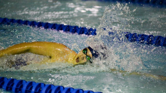 Tim Park, shown here swimming the 100-yard freestyle, helped NV/Demarest win the Public C title.