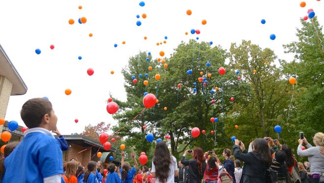 Students releasing balloons in 2016 to celebrate Armenia's 25 years of independence. Environmental and business groups are at odds over the effects of such releases on wildlife.