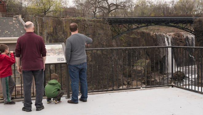 (From left) Zev Glaser, David Glaser, Matan Glaser and Eli Glaser watch the falls on Saturday, April 15, 2017. David Glaser from Glen Rock takes everyone who visits him to see the falls. The rest of the Glasers are up from Washington D.C. on a trip.