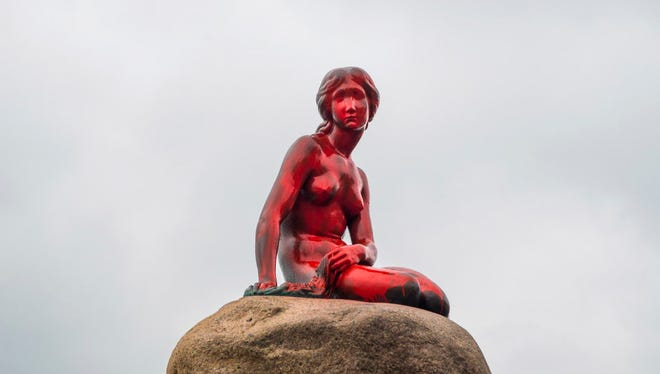 The Little Mermaid statue covered with red paint in Copenhagen on May 30, 2017.