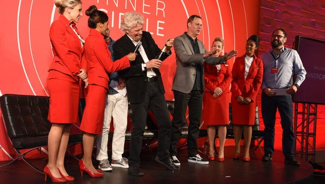 Female flight attendants with Virgin Atlantic will no longer be required to wear makeup and can opt to wear pants rather than skirts, the airline announced.
