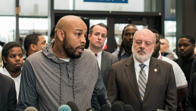 Leonard Gipson, one of 15 convicted men, talks to reporters after a judge in Chicago threw out the convictions of the men, who say a corrupt Chicago police sergeant manufactured evidence that sent them to prison, Thursday, Nov. 16, 2017, in Chicago.
