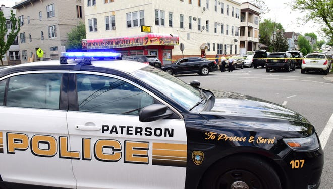 Paterson police investigate a shooting on East 28th Street at 10th Avenue earlier this year.