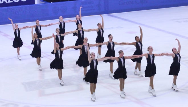 Hamilton's Abby Dowse (second from right, front row) and her teammates compete in synchronized skating.