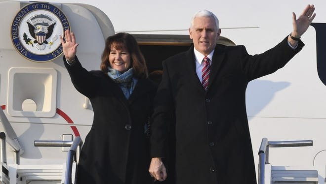U.S. Vice President Mike Pence (R) and his wife Karen Pence wave upon arriving at the Osan Air Base on February 8, 2018 in Pyeongtaek, South Korea. Vice President Pence is visiting South Korea to lead the U.S. delegation in the opening ceremony of Pyeongchang Winter Olympic Games.