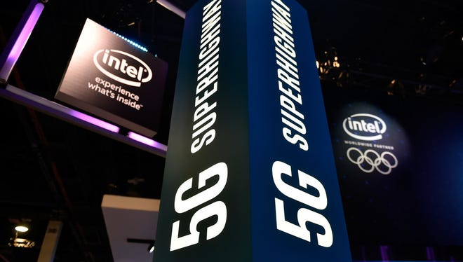Signage for 5G technology is displayed at the Intel booth during CES 2018 at the Las Vegas Convention Center on January 9, 2018 in Las Vegas, Nevada.
