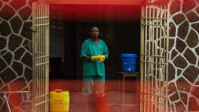 An attendant charged to handle the access to the Ebola security zone stands at the entrance of the Wangata Reference Hospital in Mbandaka, northwest of DR Congo on May 20, 2018.