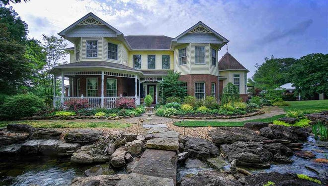 This lakefront home in Newburgh offers a  picturesque private setting on six acres of land.