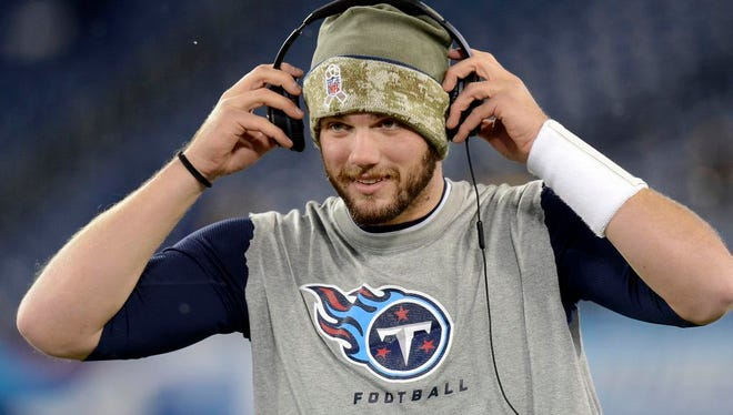Tennessee Titans quarterback Zach Mettenberger puts on headphones as he warms up before an NFL football game against the Pittsburgh Steelers Monday, Nov. 17, 2014, in Nashville, Tenn. (AP Photo/Mark Zaleski)