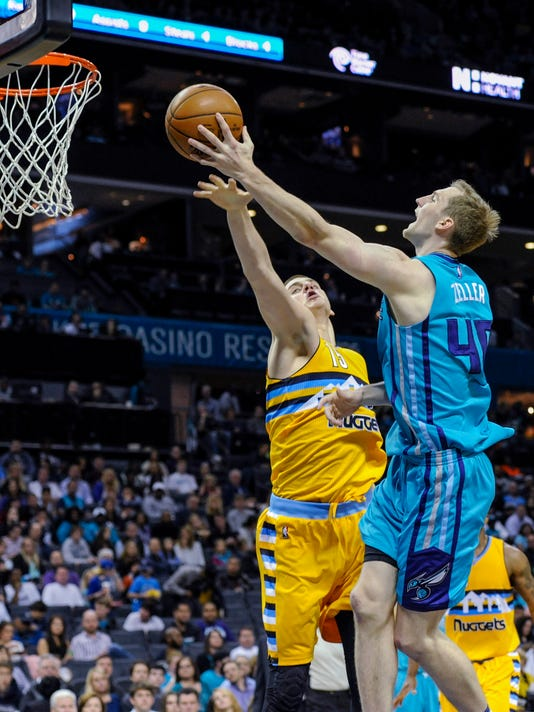 Charlotte Hornets center Cody Zeller (40) shoots as Denver Nuggets' Nikola Jokic (15) defends during the first half of an NBA basketball game in Charlotte, N.C., Saturday, March 19, 2016. (AP Photo/Mike McCarn)