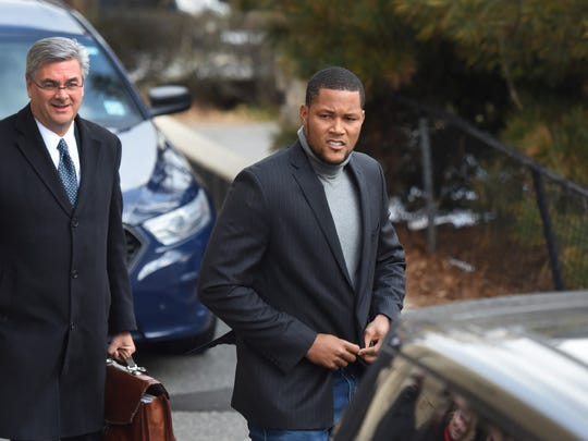 Mets closer Jeurys Familia leaving from a side door of Fort Lee Municipal Court building after charges were dropped on Dec. 15, 2016.