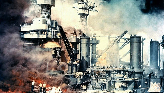 The USS West Virginia burns Dec. 7, 1941, after the surprise attack by Japan on Pearl Harbor. The battleship was sunk but was later salvaged.