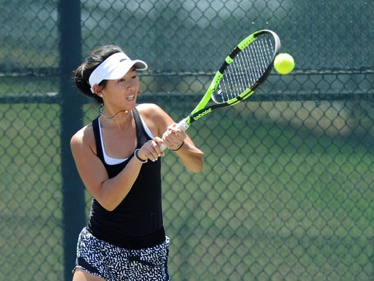 Rider sophomore Julia Chon returns a shot at the UIL State Tennis Tournament Thursday. Chon and Casie Curry defeated Highland Park 6-2, 6-1 and then fell to Alamo Heights 6-2, 6-0 in the semifinals at the Mitchell Tennis Center. Chon and Curry entered the state tournament with an undefeated record this season.