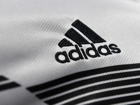 The Adidas company logo is on display during the company's