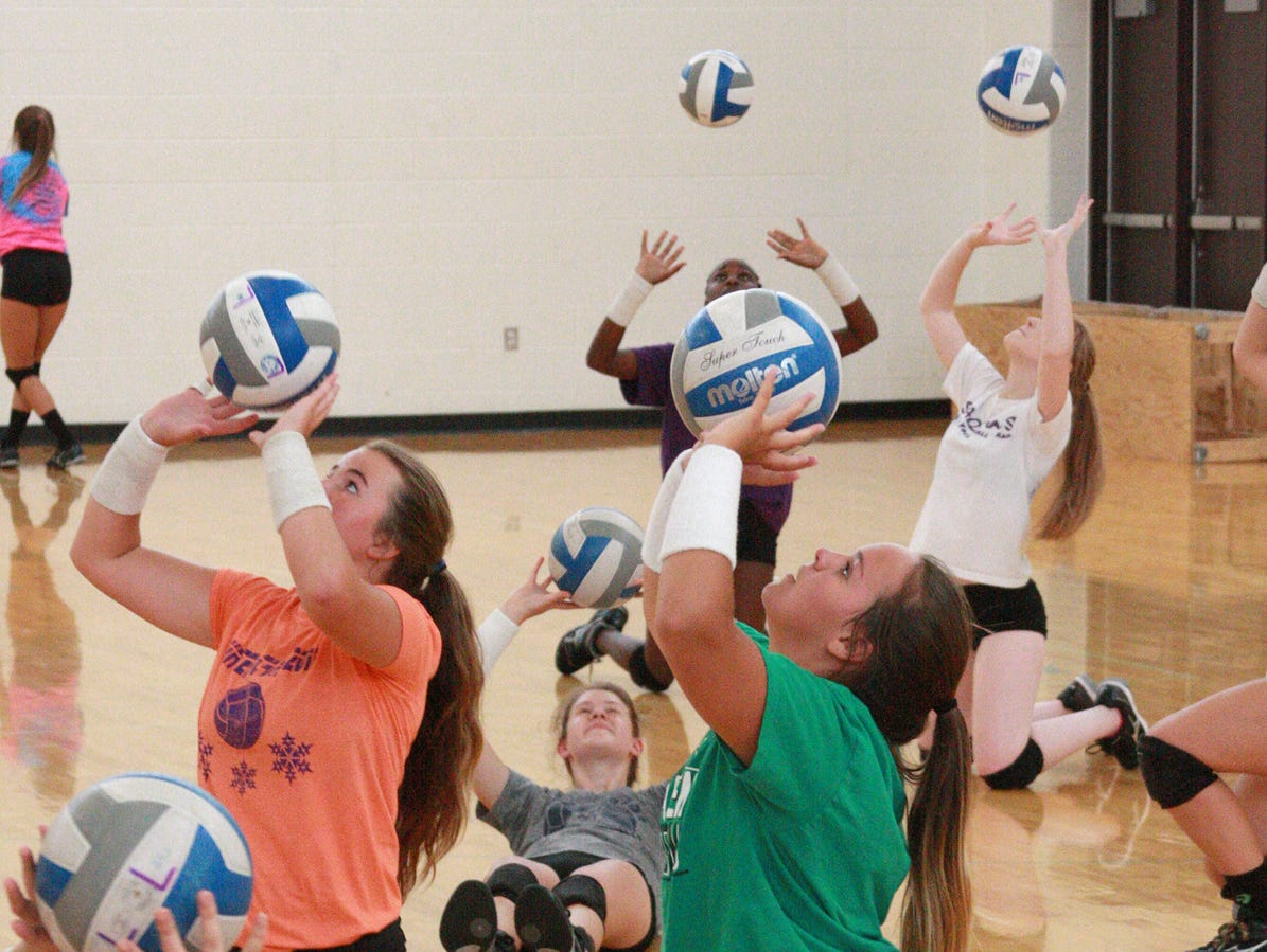 Lakeview High School volleyball players practice the basics of setting during tryouts on Wednesday.
