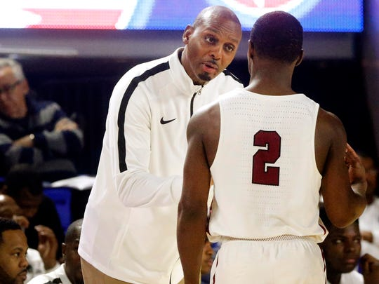 "Memphis East's head coach Anfernee ""Penny"" Hardaway coaches works with Alex Lomax (2) near the sidelines during the game against Blackman in the quarterfinals of the TSSAA Boys State Basketball Tournament on Wednesday, March 14, 2018, at MTSU."