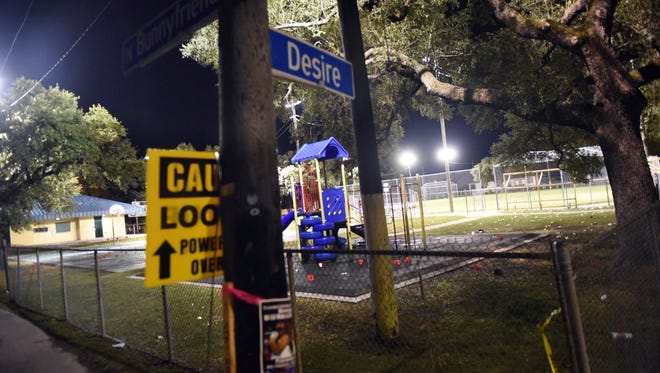 NEW ORLEANS, LA - NOVEMBER 22: Evidence markers sit on the ground after a shooting at a playground on November 22, 2015 in New Orleans, Louisiana. According to reports, as many as 17 people were shot at Bunny Friend Park. (Photo by Cheryl Gerber/Getty Images)