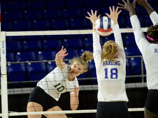 Webb's Nicklin Hames attempts a kill during Friday's Division II-A champion match at MTSU's Murphy Center.