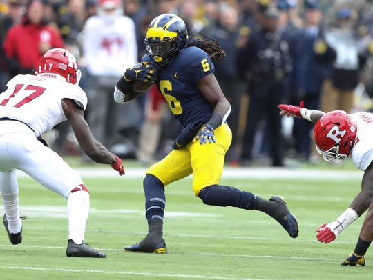 Kareem Walker runs the ball against Rutgers in the second quarter Saturday.