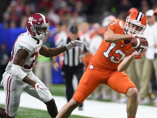 Clemson wide receiver Hunter Renfrow (13)  catches a pass past Alabama defensive back Levi Wallace (39) during the 4th quarter of the Allstate Sugar Bowl at the Mercedes-Benz Superdome in New Orleans on Monday, January 1, 2018.