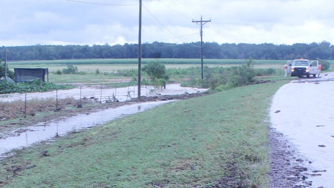 Water runs over Sand Valley Road in Jefferson County Thursday, Sept. 17.