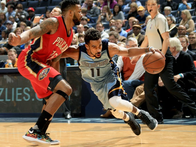 January 18, 2016 -  Memphis Grizzlies Mike Conley drives to the basket defended by New Orleans Pelicans Alonzo Gee at FedExForum.