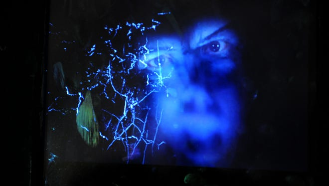 """Holograms pop out at visitors to the The Haunted Prison Experience """"Supernatural II"""" at the Ohio State Reformatory."""