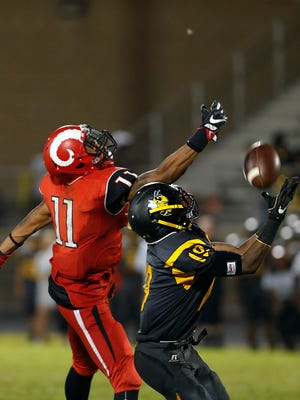 Central's Quincy Baines hauls in the interception against Manual's Jaelin Carter. Aug. 19, 2016