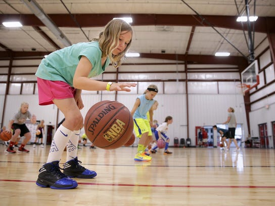 Laina Hammen, 9, works on a dribbling drill during
