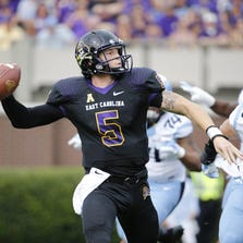 Pirates quarterback Shane Carden (5) gets ready to throw the ball during the first quarter against the North Carolina Tar Heels at Dowdy-Ficklen Stadium.