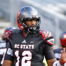 North Carolina State Wolfpack quarterback Jacoby Brissett (12) looks on before the start of the game against the Old Dominion Monarchs at Carter Finley Stadium.
