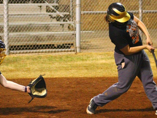 Bella Barajas connects for a base hit during practice Wednesday night. Alamogordo begins the season March 8 hosting Las Cruces High.