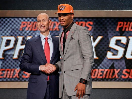 North Carolina State's T.J. Warren, right, poses for a photo with NBA Commissioner Adam Silver after being selected 14th overall by the Phoenix Suns during the 2014 NBA draft, Thursday, June 26, 2014, in New York.