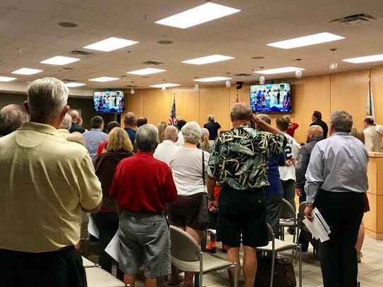 Marco Island residents and city councilors stand during